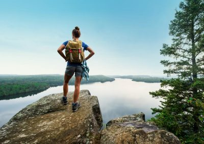 GrandMarais_HoneymoonBluff_Woman_Hiking01_Roy Son_DkrBlue_forHeadline